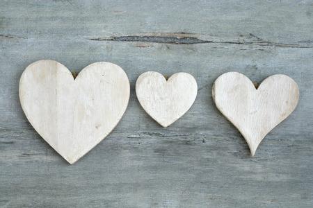 whitewash: gray wooden background with empty copyspace whitewash heart shape Stock Photo