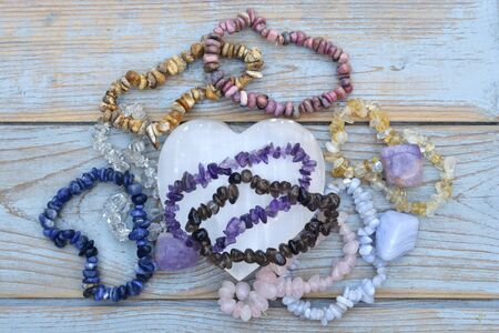 Healing gem stones and crystals on a wooden background