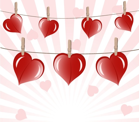 hearts on rope on sunny background.