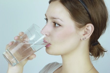 Young woman drinking water Stock Photo - 13111423