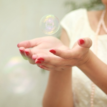 Bubble in hands photo