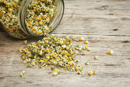 Chamomile tea in the jar on the wooden table  Stock Photo