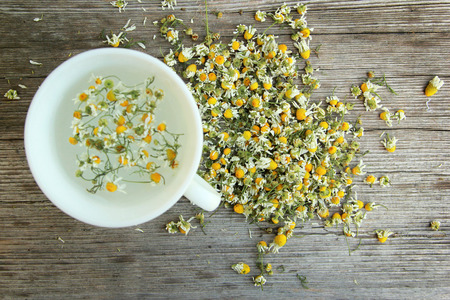 Chamomile tea on the wooden table  photo