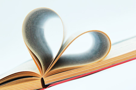 Book open on the table with heart shaped pages  photo