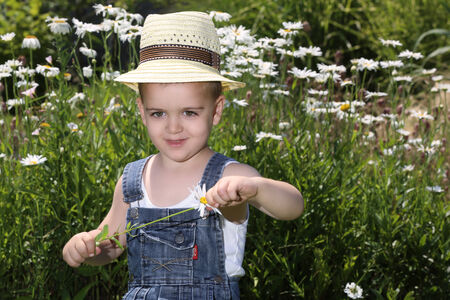 Cute child in the garden during the summer day photo