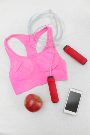 pink bra: Fitness, Ready for gym - jumping rope with sport bra, an apple and tablet on white
