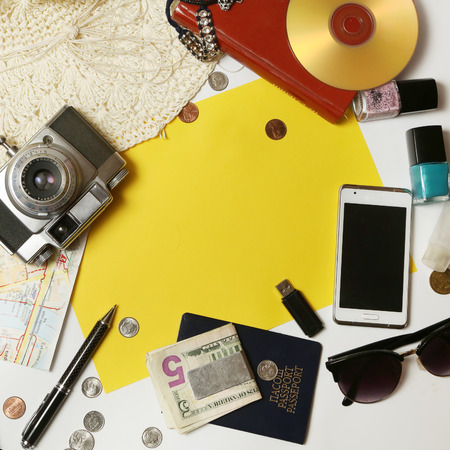 Yellow paper surrounded with everyday items - planning and organization concept. Add own text. photo