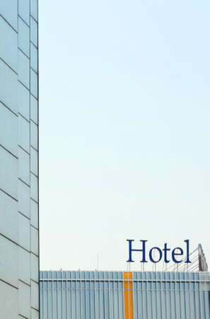 hotel building: Hotel sign on the top of modern building