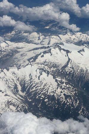 window view: Aerial view of mountains through airplane window
