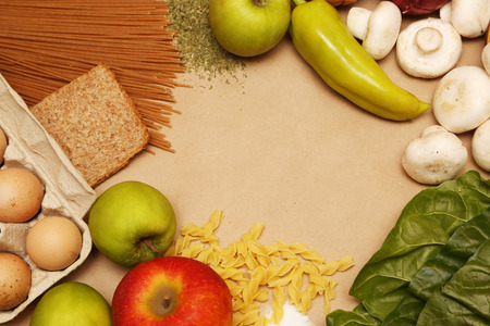 basic food: Blank paper surrounded by basic food ingredients. Add own text.
