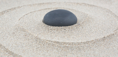 Zen garden - spa stone in the sand. Meditation, spirituality and harmony concept