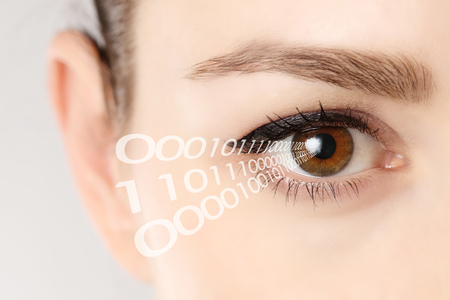 close the eye: Close-up of eye of woman with binary code Stock Photo