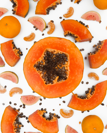 Fruit background - papaya, guava and mandarine on white background