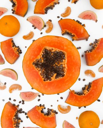 Fruit background - papaya, guava and mandarine on white background