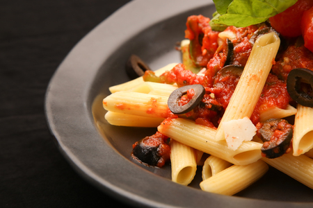 stirred: Penne pasta in tomato sauce Stock Photo