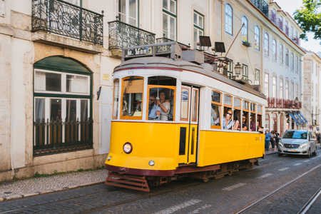 Classic yellow tram on the streets of Lisbon, Portugal