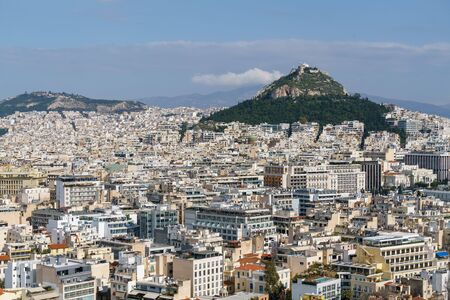 Athens cityscape, and Lycabettus Hill with blue sky Stock Photo
