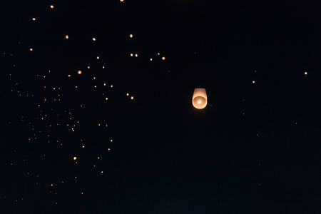 Lanterns flying in the sky during Chiang Mai lantern festival