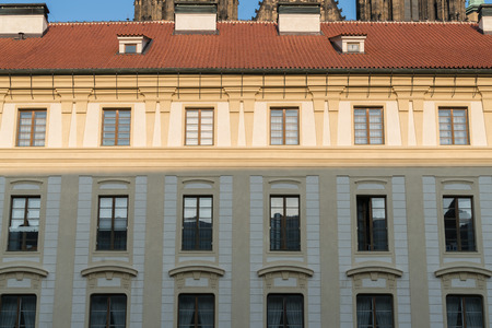 Wall background of old city buildings in Prague, Czech Republic, walls of retro buildings and red tile roofs 新聞圖片