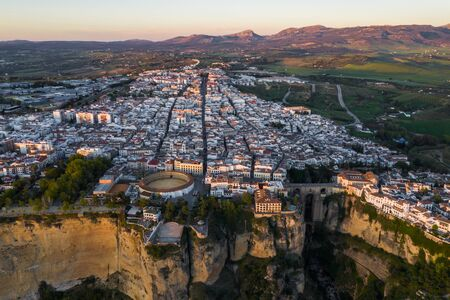 Aerial view of Ronda village, a village with white houses at the edge of cliffside in Andalusia, Spain