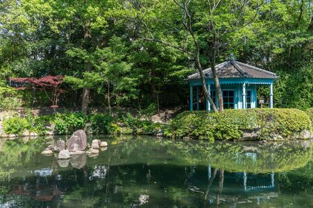 Japanese style garden and lake with a Octagonal Pavilion in Shitennoji Temple in Osaka, Japan Editorial