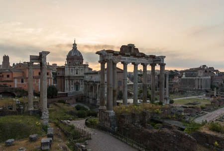 Sunrise landscapes of the empty Roman Forum, view of the Temple of Vespasian and Titus