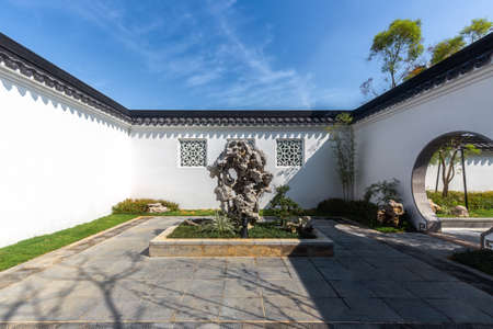 Chinese traditional garden building, entrance courtyard with a stone carving decoration