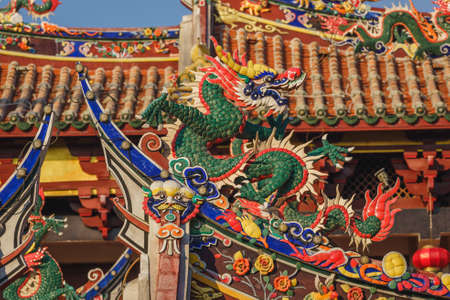 Close-up view of the architecture, traditional Chinese temple building with dragon statues in Tonghuai Temple of Guan Yu and Yue Fei on Tumen Street in Old Quanzhou city, Fujian, China