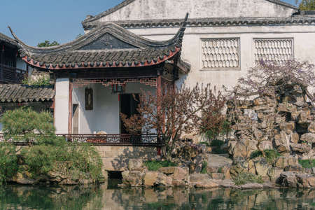 Landscape and buildings in Master of the Nets Garden, a classical Chinese garden in Suzhou, China