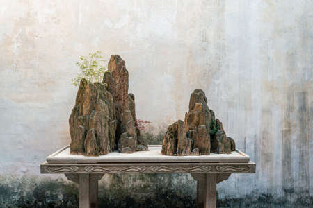 Landscape and buildings in Couple's Retreat Garden, a classical Chinese garden in Suzhou, China Stock Photo