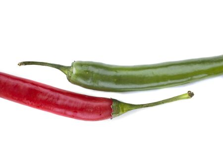 isolated  Red and green chili peppers vertical photo