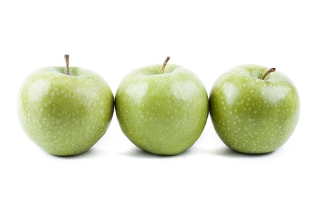 isolated three green apples in a row photo