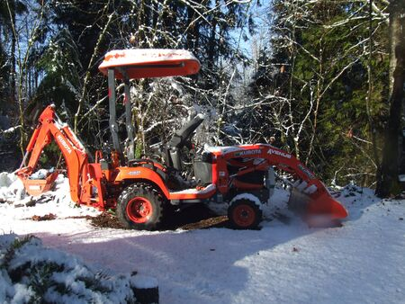 Tractor on the snow in winter