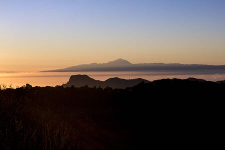 Amazing view sunset at Roque Nublo park and Teide peak from Tenerife island, Gran Canaria and Tenerife Canary Islands. Spain.