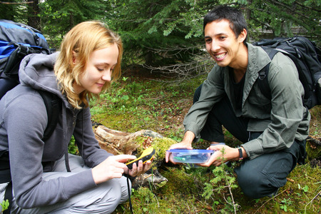 Two hikers finding a geo cache