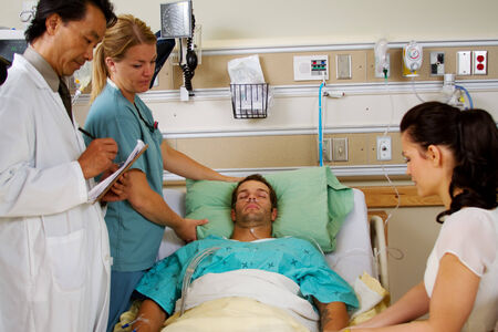Doctor reviewing health status of patient