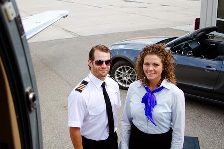 Pilot and stewardess preparing for flight Stock Photo