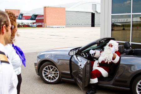 Santa arrives in convertible for flight