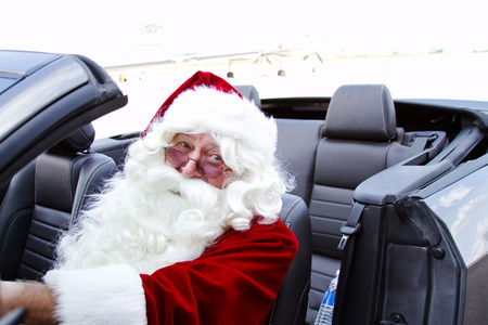 Santa driving a blue convertible
