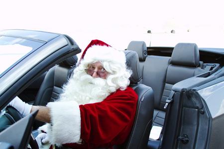 Santa Claus in convertible car