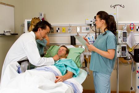 assessing: Health team assessing patient