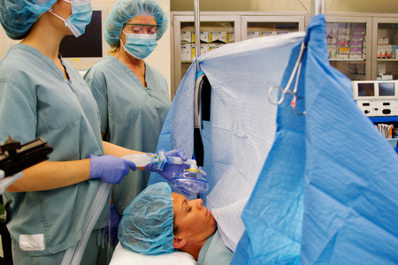 Patient and staff in operating room ready for surgery Stock Photo
