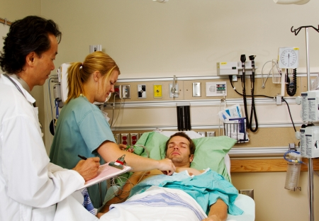 assessing: Nurse and Physician assessing patient