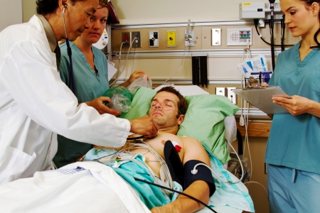assessing: Doctor assessing patient in Emergency