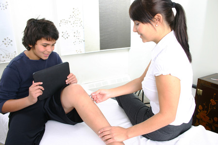 therapist providing spa treament to child Stock Photo