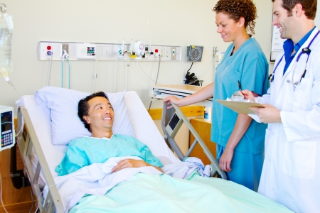 Patient enjoying a laugh with Doctor and nurse photo