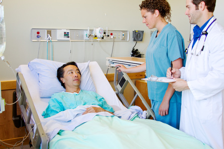 Doctor and nurse discussing care with patient photo