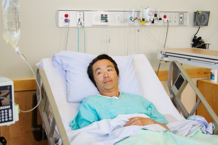 Patient laying in hospital bed Stock Photo