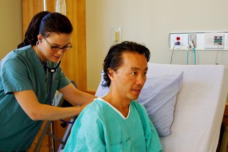 Nurse listening to patients chest