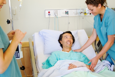 reassurance: Nurse giving patient reassurance and comfort Stock Photo